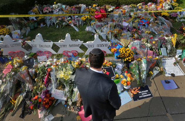 A man prays at a makeshift memorial outside the Tree of Life synagogue in Pittsburgh, Pennsylvania, Oct....