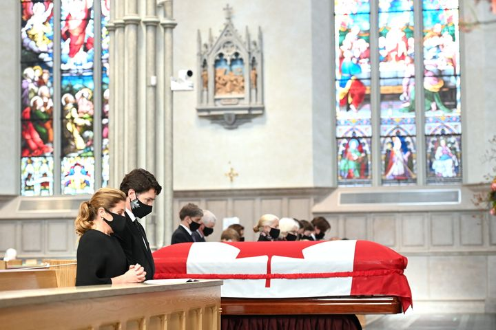 Prime Minister Justin Trudeau and wife Sophie Gregorie Trudeau kneel and pray during the state funeral service for former Canadian prime minister John Turner at St. Michael's Cathedral Basilica in Toronto on Tuesday, Oct. 6, 2020.