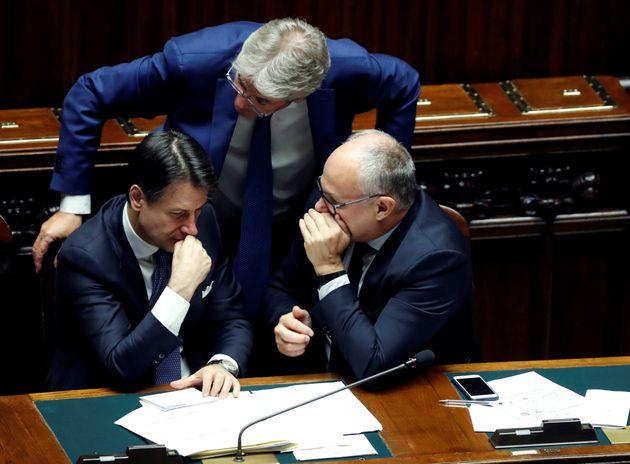 Italian Prime Minister Giuseppe Conte talks to Paolo Gentiloni and Economy Minister Roberto Gualtieri...
