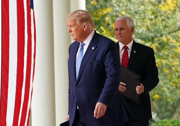 Donald Trump and Mike Pence arrive to speak on COVID-19 testing in the Rose Garden of the White House...