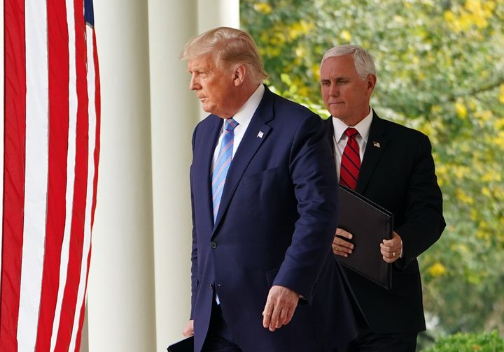 Donald Trump and Mike Pence arrive to speak on COVID-19 testing in the Rose Garden of the White House on Sept. 28, 2020. Trum