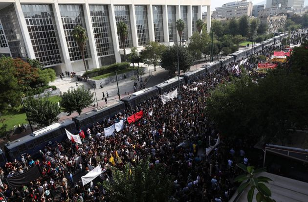 Thousands of people gather for a protest outside a court in Athens, Wednesday, Oct. 7,