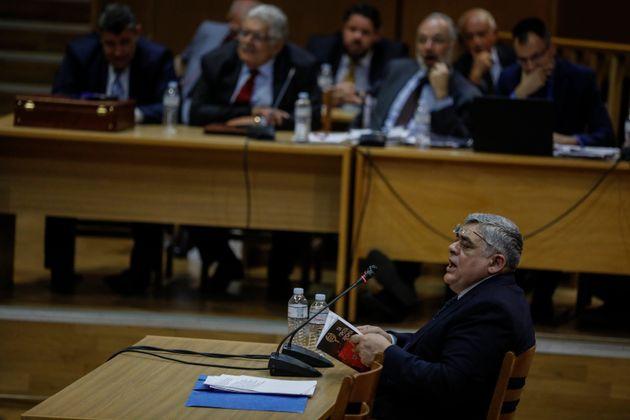 The head of Greece's extreme far-right Golden Dawn party Nikos Michaloliakos testifies on Nov. 6, 2019,...