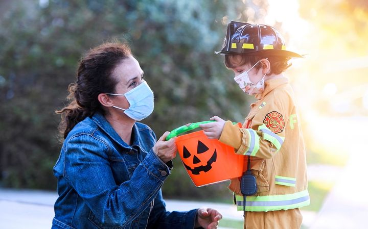 If you decide to trick-or-treat, face masks are a must.