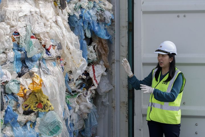 Malaysia's minister of energy, science, technology, environment and climate change Yeo Bee Yin shows plastics waste shipment from Canada before sending back to the country of origin in Port Klang on May 28, 2019.