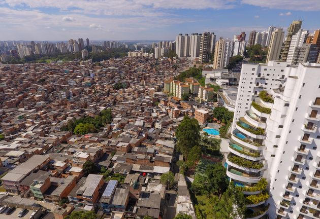 In this aerial photo of Sao Paulo, Brazil, the Paraisópolis Slum sits next to Morumbi, a wealthy...