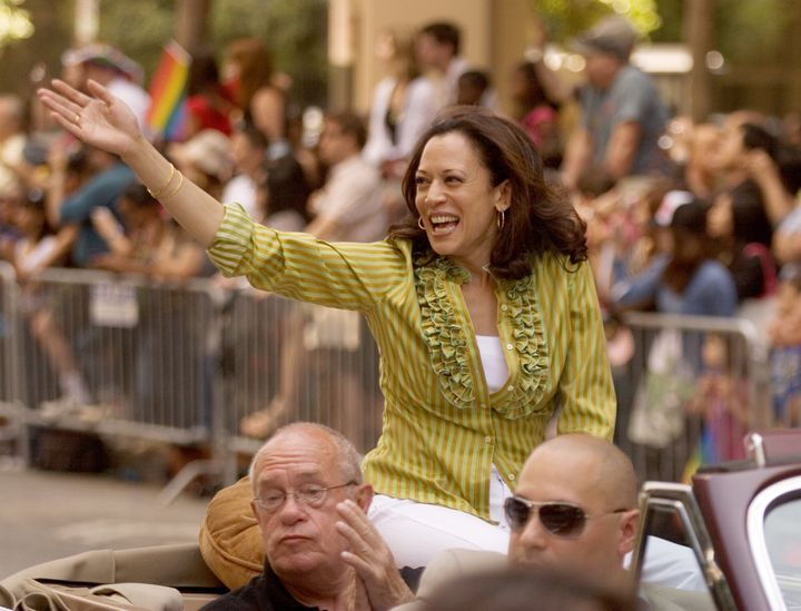 Kamala Harris, top, then San Francisco District Attorney, waves to the crowd during the annual Gay Pride Parade along Market Street in 2009.