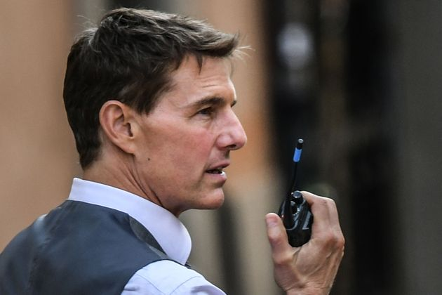 US actor Tom Cruise checks uses a talkie-walkie during the filming of