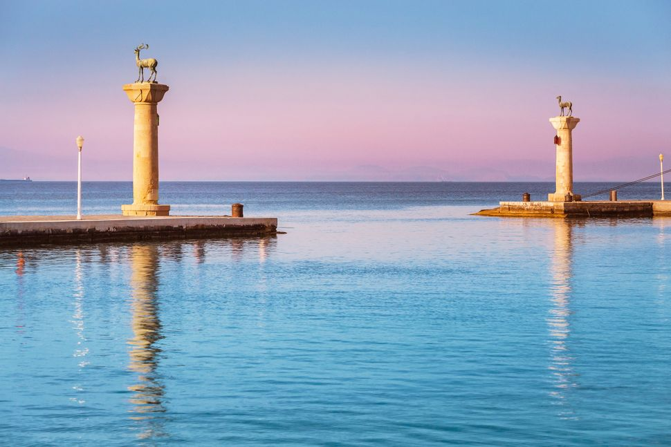 Famous tourist destination in Mandraki port with deers statue, where The Colossus was standing. Rhodes, Greece