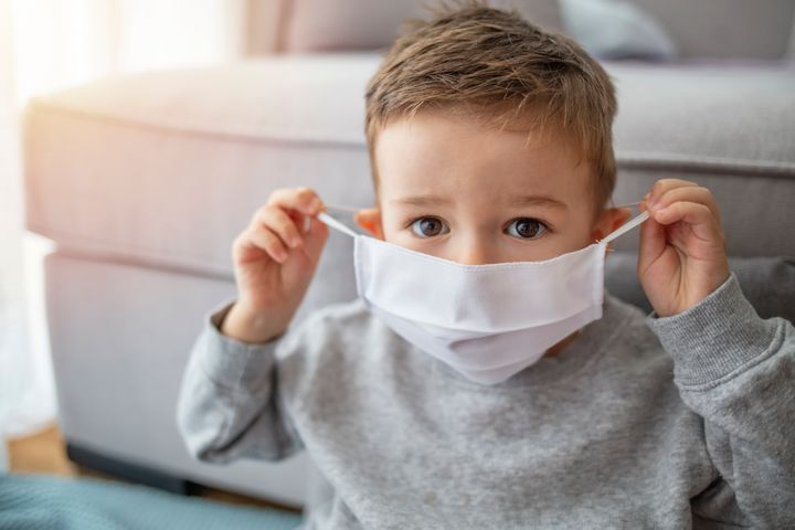 Yes, masks are still effective in preventing the spread of COVID-19, even if children keep touching them.