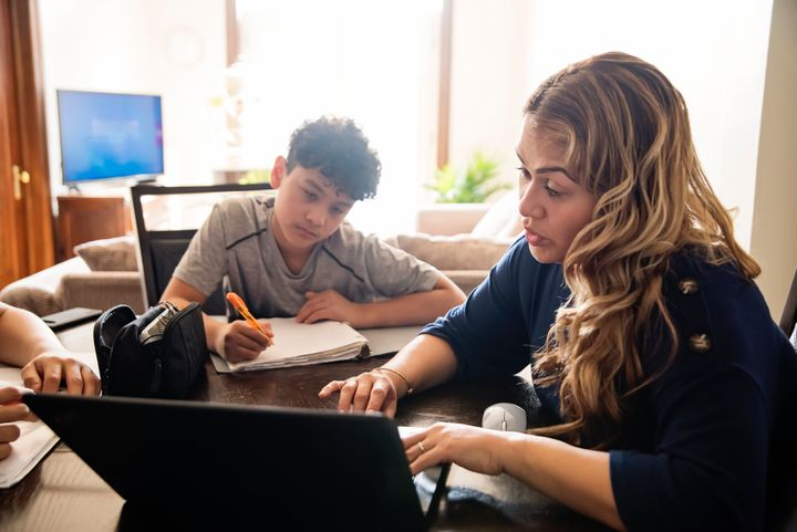 Therapists are concerned about parents' stress as they monitor their children's virtual learning while working.