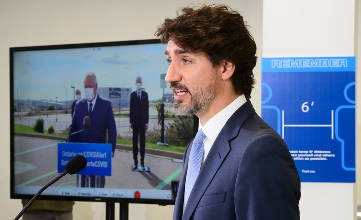 Prime Minister Justin Trudeau takes part in a press conference at the Ford Connectivity and Innovation Centre in Ottawa on Oct. 8 2020, as Ontario Premier Doug Ford is shown joining virtually.