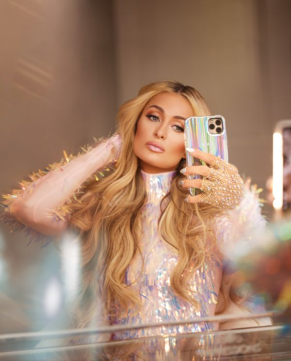 "Paris Hilton is adding a little pizazz to <a href=""https://case-mate.com/collections/lumee-paris-hilton-holographic-collectio"