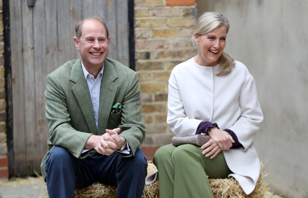 Prince Edward and Sophie, Countess of Wessex smile during a visit to see Vauxhall City Farm's community...