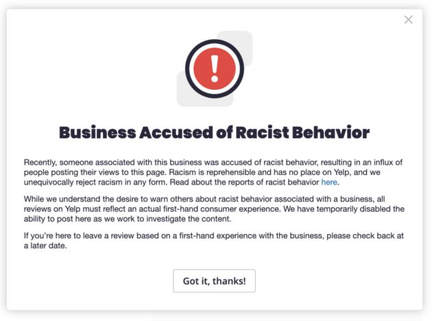 Yelp's alert for restaurants accused of racist behaviour, as shown on the app's
