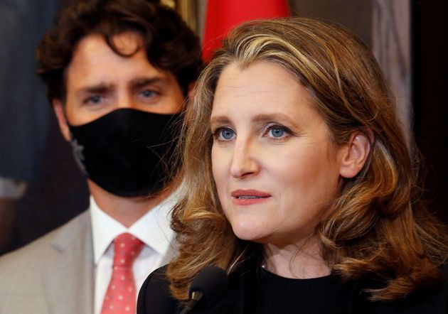 Deputy Prime Minister and Finance Minister Chrystia Freeland speaks to reporters next to Prime Minister...