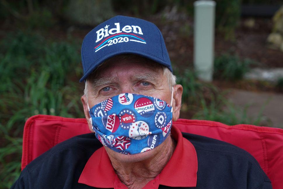 Ed McGinty, a 71-year old retiree from Philadelphia, wears a Biden 2020 hat on July 23.As Trump's popularity plummets a