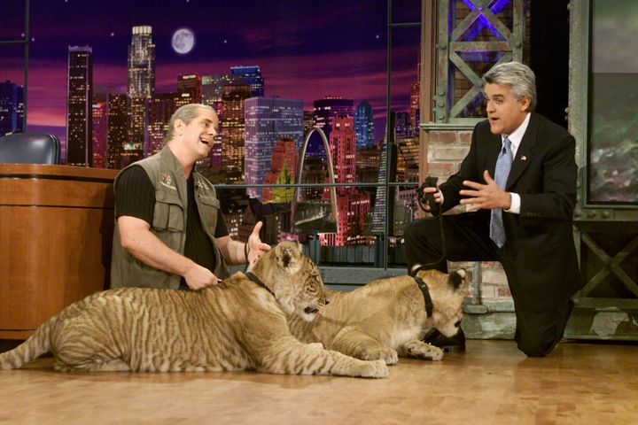 """Doc Antle with two big cats during an interview with """"Tonight Show"""" host Jay Leno on May 1, 2002."""