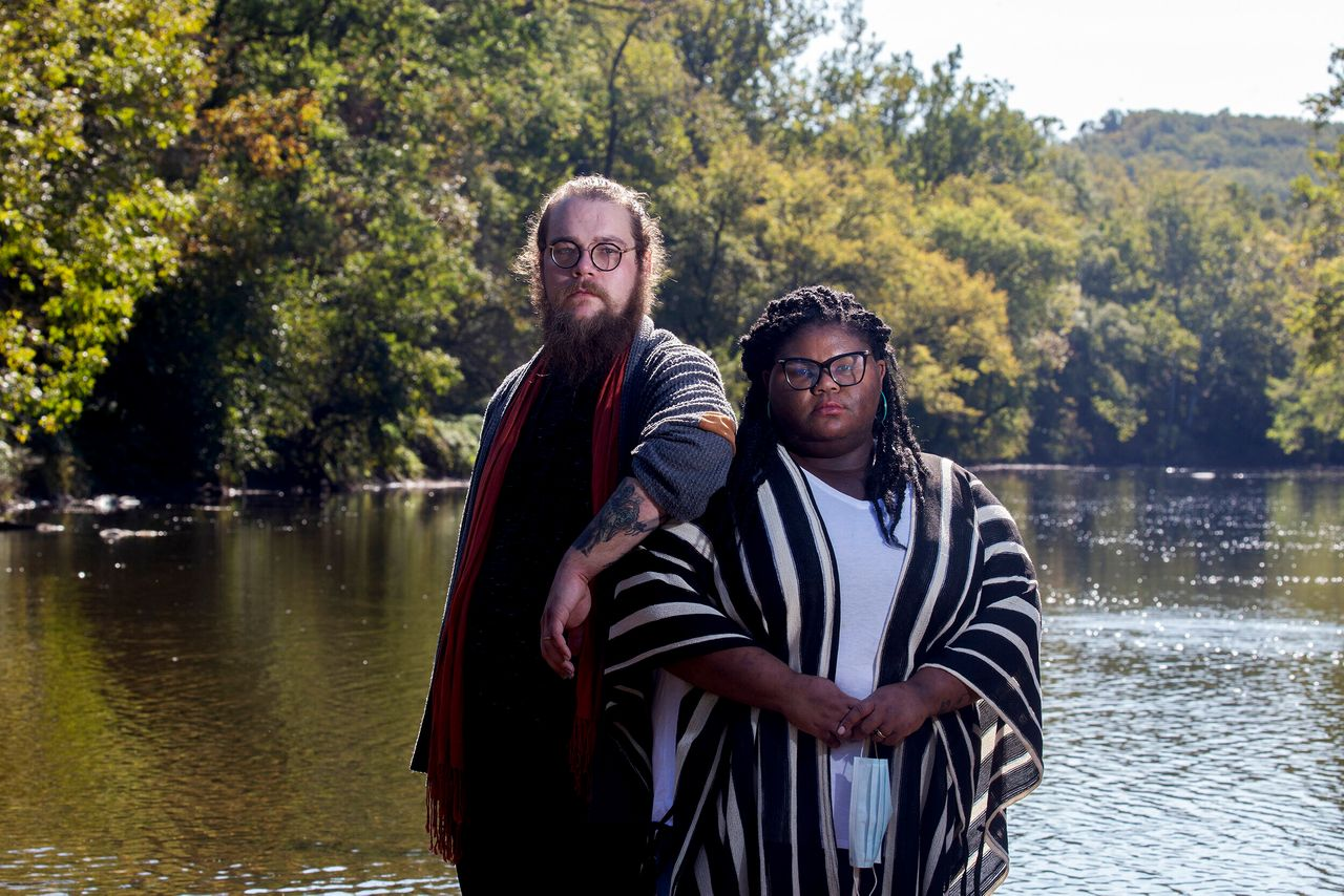 Kitzo-Creed and her husband Aaron stand in the middle of Brandywine Creek at the First State National Historic Park in Wilmington, Delaware, on Oct. 9, 2020. The park is one of the few places they feel comfortable visiting as political tensions and rates of COVID-19 rise in the United States.