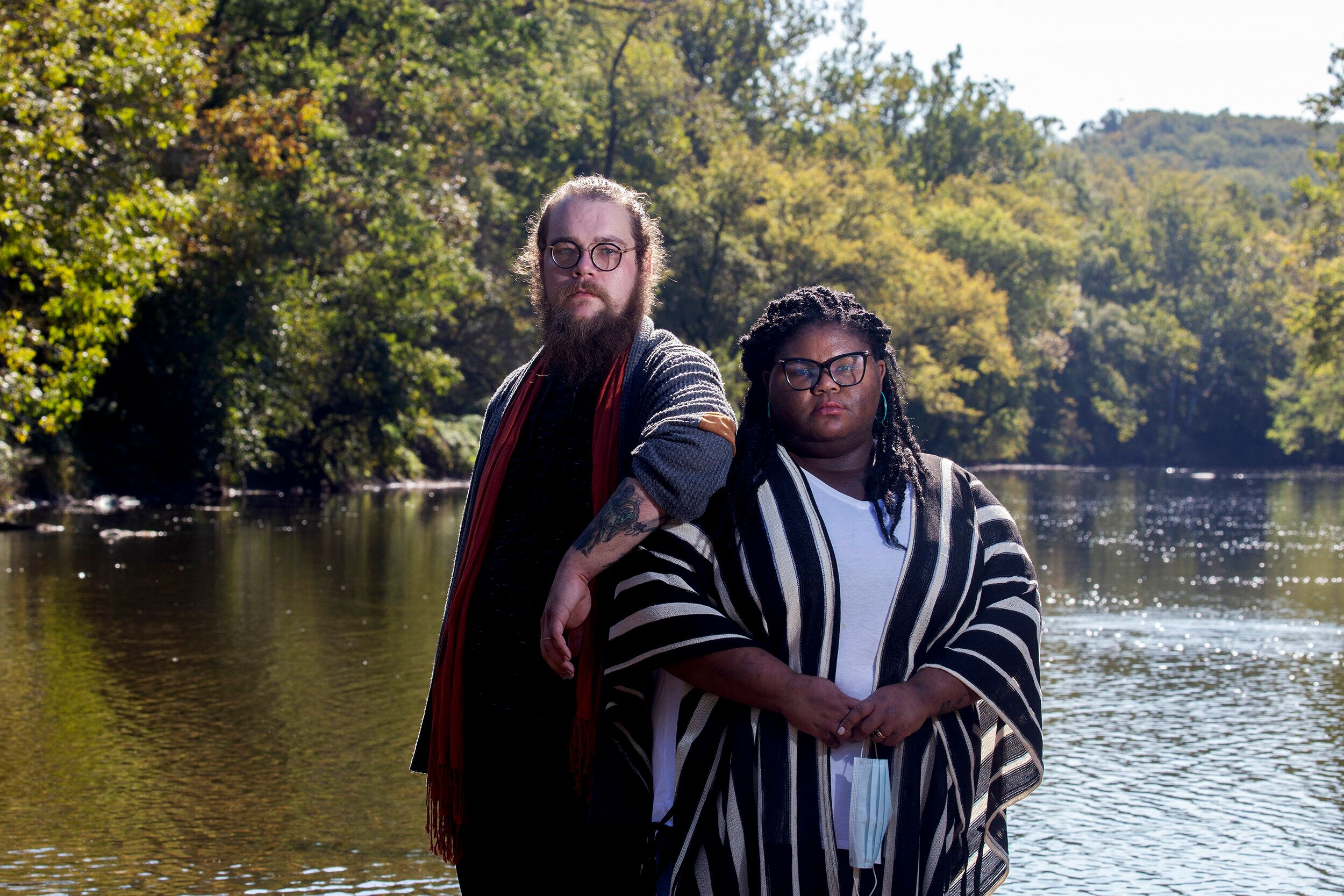 Kitzo-Creed and her husband Aaron stand in the middle of Brandywine Creek at the First State National Historic Park in Wilmin