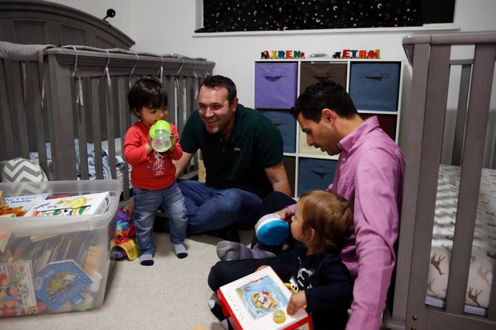 AndrewDvash-Banks (right) and his husband,Elad, play with their twin sons, Ethan and Aiden.