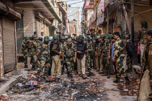 Indian paramilitary forces patrol in the majority community in a riot- affected area on February 28,...