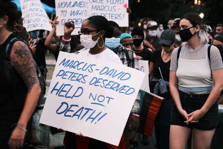 RICHMOND, VA - JULY 28: Protesters holding a sign that reads Marcus-David Peters Deserved HELP Not DEATH!! at a  demonstratio