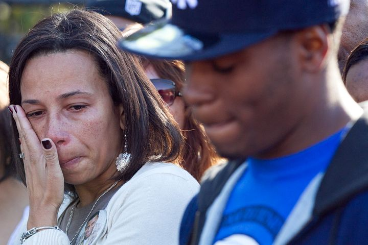 EASTON - OCTOBER 17: Danroy Henry's mother Angela wipes away a tear as Brandon Cox who was with Henry the night he was killed