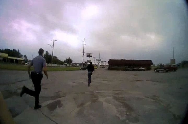 Police chase Derrick Scott before detaining him in Oklahoma City, Oklahoma, U.S., May 20, 2019 in this framegrab from police
