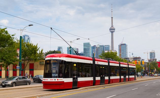 A streetcar runs down Toronto's Spadina Ave. in this file photo taken Sept. 9, 2014. Toronto had...