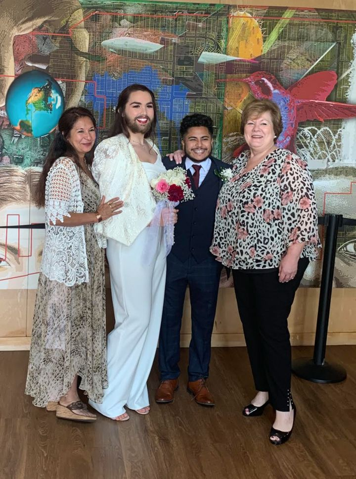 The author at their wedding with their husband, Ethan, their mother (right) and Ethan's mother (left) in 2019.