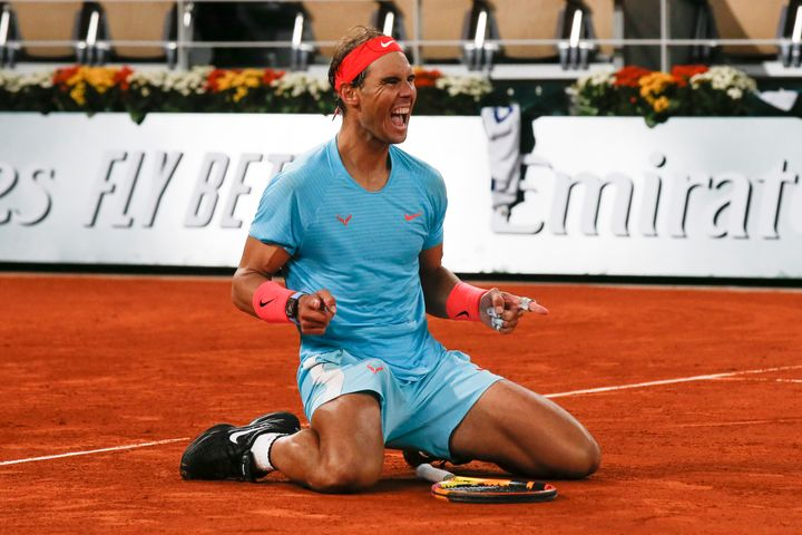 Spain's Rafael Nadal celebrates winning the final match of the French Open tennis tournament against Serbia's Novak Djokovic