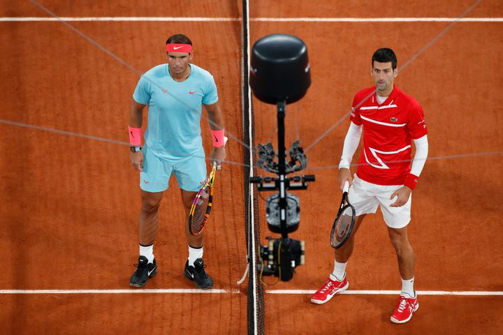 Serbia's Novak Djokovic, right, and Spain's Rafael Nadal are filmed by a remote camera as they pose for images prior to the f