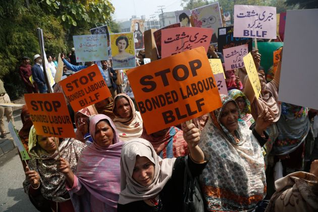 In this March 8, 2020 file photo, Pakistani activists take part in an International Women's Day rally...