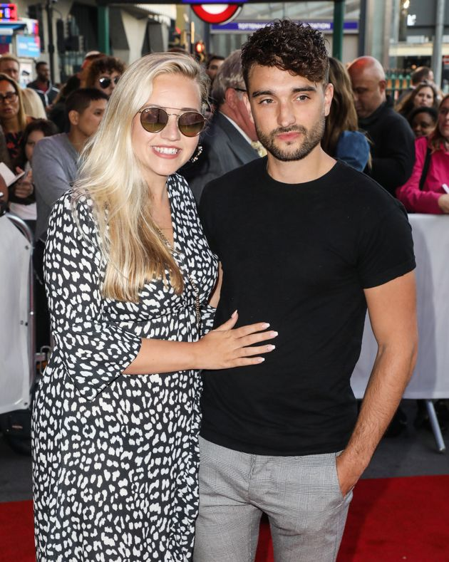 Tom with his wife Kelsey, pictured in September