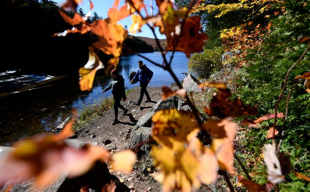 People take in the fall colours at Meech Lake in Chelsea, Que., on Oct. 11,