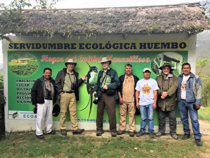 Constantino Aucca (left) with Santos Montenegro (third from right), other ECOAN staff, and donors from American Bird Conserva