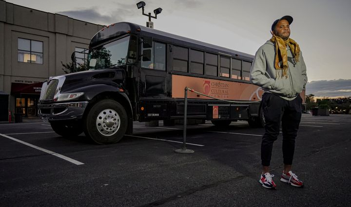 Keith White, director of social justice initiatives at Christian Cultural Center, stands next to a bus the church plans to update with COVID-19 protocols to transport people to the polls on Election Day, Friday, Sept. 18, 2020, in the Brooklyn borough of New York.
