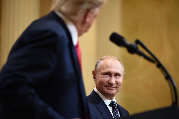 "U.S. President Donald Trump and Russia's President Vladimir Putin at what became an <a href=""https://www.npr.org/2018/07/17/6"