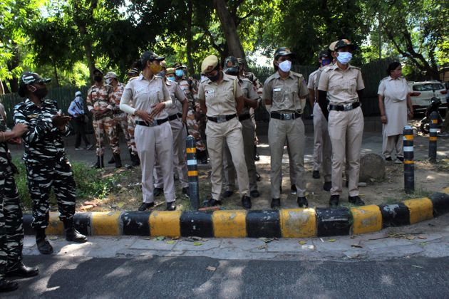 Security personnel are seen outside the Uttar Pradesh Bhawan during a demonstration in New Delhi on September...