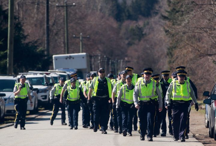 RCMP officers arrive to deal with protesters blocking a gate outside Kinder Morgan, in Burnaby, B.C., on March 17, 2018.