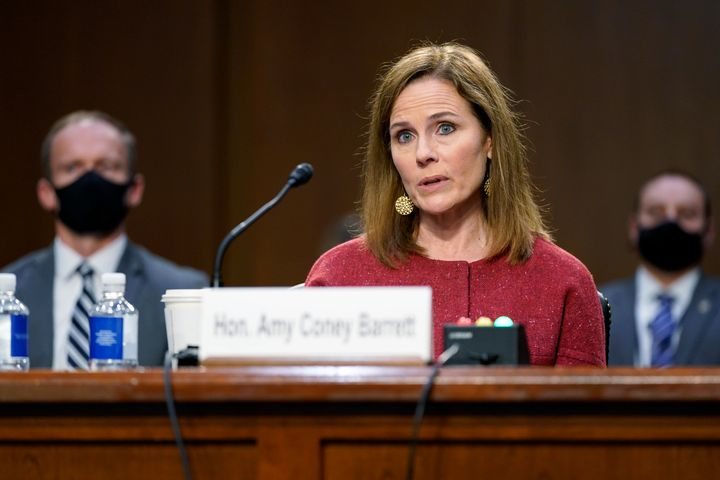 Despite comments by Republicans to the contrary, Democratic members of the Senate Judiciary Committee have shied away from pressing Supreme Court nominee Amy Coney Barrett about the impact her Catholicism might have on her rulings. Barrett is shown here at Tuesday's confirmation hearing before the panel.