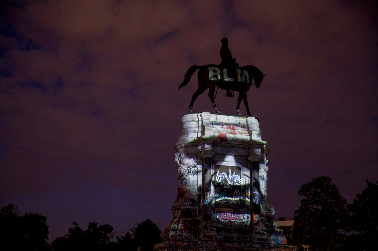 The image of George Floyd, a Black man who was killed at the hands of police earlier this year, is projected onto the Robert E. Lee Monument on June 18 in Richmond, Virginia. Richmond Circuit Court Judge Bradley Cavedo on Thursday ruled to indefinitely extend an injunction preventing the state governor from removing the historic statue of the Confederate general from Richmond's famed Monument Avenue.