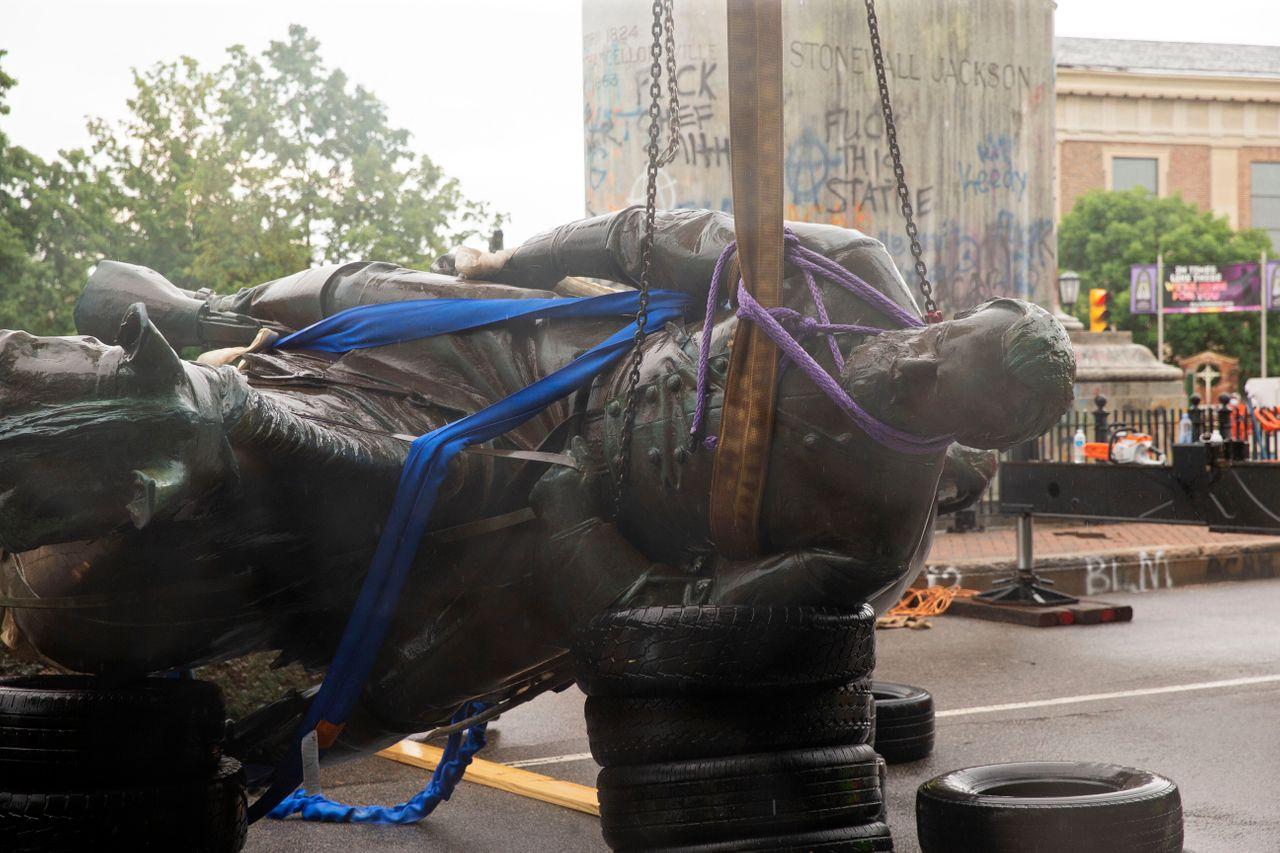 """The Stonewall Jackson statue is removed from Monument Avenue in Richmond, Virginia, on July 1. Workers in Richmond removed the statue of Thomas """"Stonewall"""" Jackson, a Confederate general, after the city's mayor ordered the """"immediate removal"""" of Confederate monuments."""