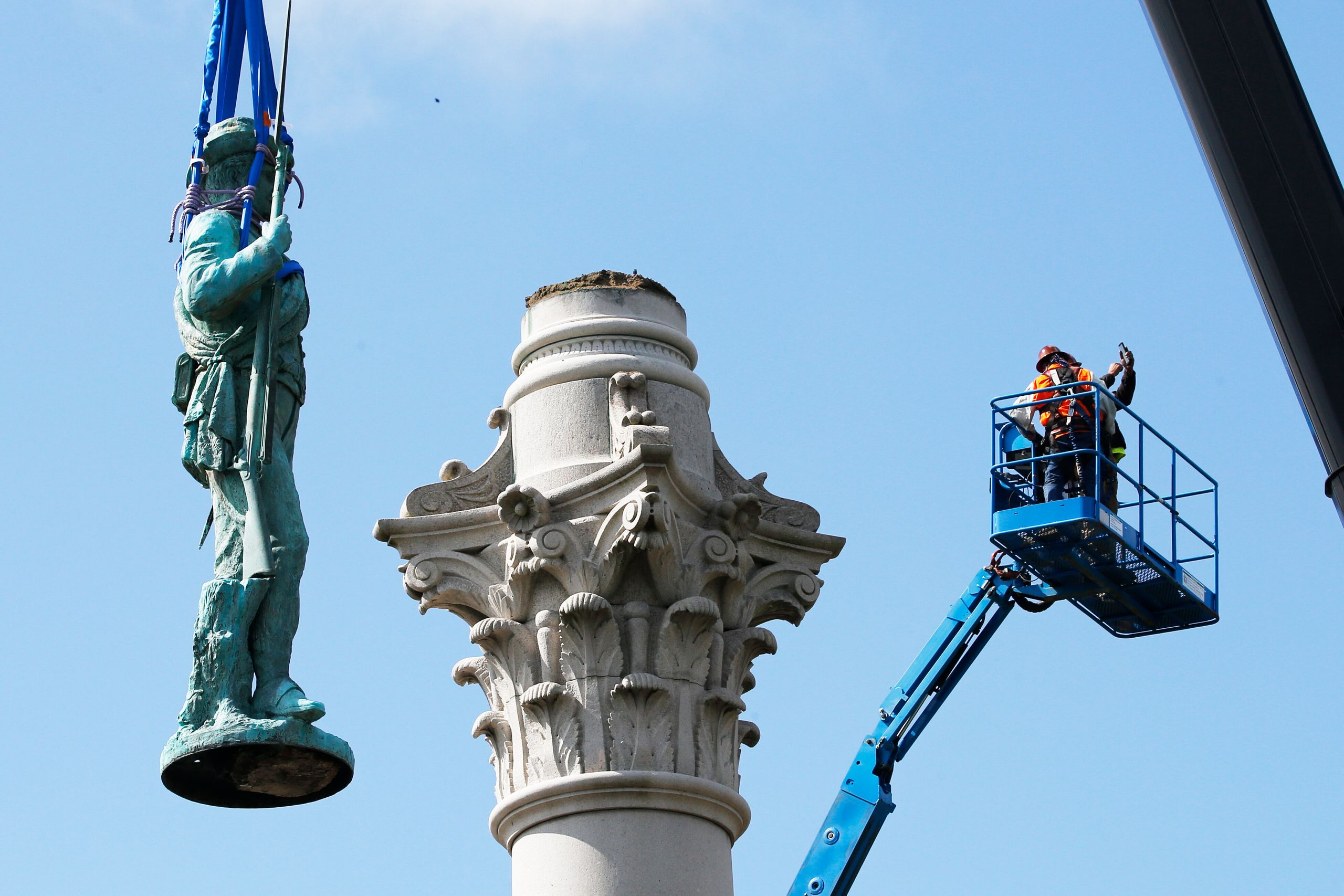 Crews remove the Confederate Soldiers and Sailors Monument in Libby Hill Park in Richmond, Virginia, on July 8. At least 63 C
