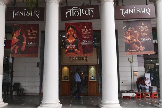 A man walks past a 'Tanishq' jewellery showroom in a shopping arcade in New Delhi on October 14,