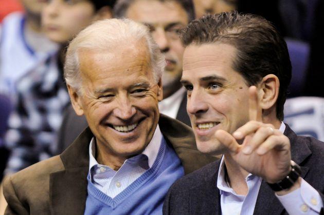 U.S. Vice President Joe Biden and his son Hunter Biden attend an NCAA basketball game between Georgetown...