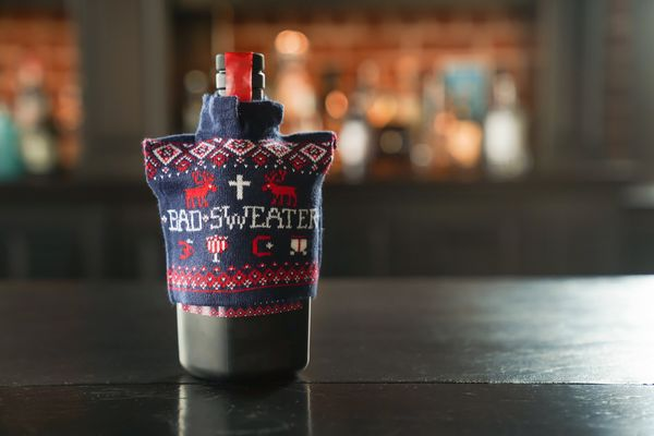 "Why should ugly holiday sweaters be limited to sentient beings? This <a href=""https://www.savageandcooke.com/spirits/bad-swea"