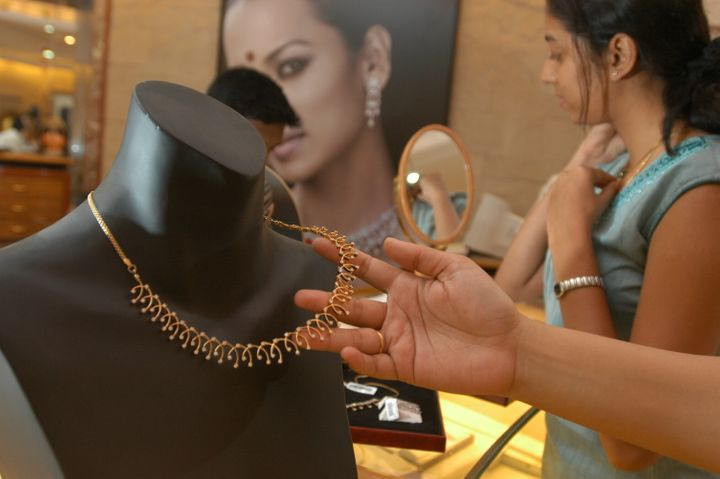 Shoppers pick out jewelry from a Tanishq store in Bangalore, India.
