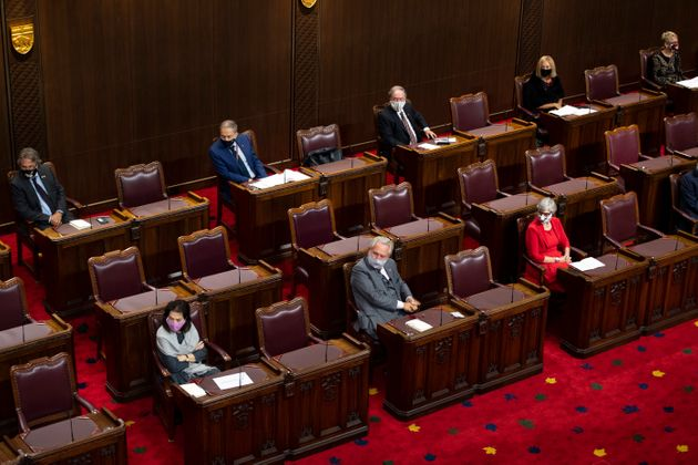 Senators sit physically distanced as they listen throne speech in the Senate of Canada building in Ottawa...